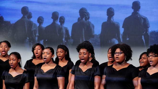 Stax Academy choir members perform during a ceremony at the National Civil Rights Museum to announce the 10 Tennessee historic sites on the new, multi-state U.S. Civil Rights Trail.