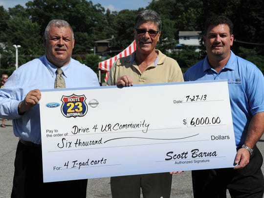 Route 23 Auto mall in Butler hosts second annual AP Challenge, a New Jersey contest that gives students the chance to win a car. Steve Secor, Sales; Paul Scutti, Principal Martin J. Ryerson School; Scott Barna, President at Route 23 Auto Mall Ford-Nissan in July 2013.