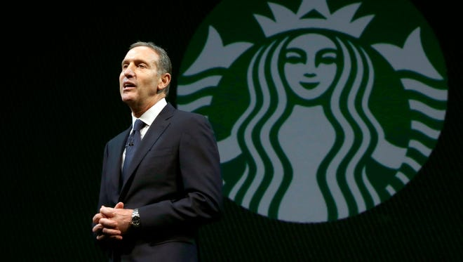 Starbucks CEO Howard Schultz speaks at the company's annual shareholders meeting on March 20, 2013.