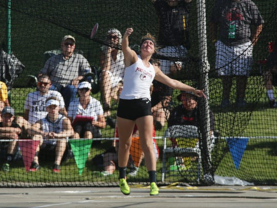 Port Clinton's Rachel Simpson throws the discus during the Division II state track meet Friday at Jesse Owens Memorial Stadium.