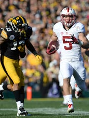 Stanford running back Christian McCaffrey runs for a touchdown against Iowa in the first quarter of the Rose Bowl on Friday. The Cardinal won 45-16. McCaffrey rushed for 172 yards on 18 carries and caught four passes for another 104 yards.