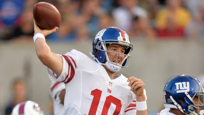 Giants quarterback Eli Manning throws a pass in the first quarter against the Buffalo Bills in the Pro Football Hall of Fame game on Sunday, in Canton, Ohio.