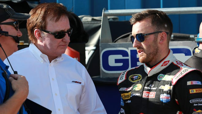 Austin Dillon talks with team owner Richard Childress, who is also his grandfather, before a practice session at Michigan International Speedway.