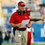Cajuns head coach Mark Hudspeth is shown on the sideline against Kentucky earlier this season.
