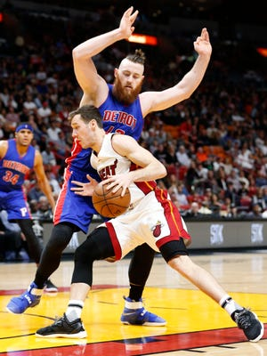 Miami Heat guard Goran Dragic drives to the basket against Detroit Pistons center Aron Baynes during the second half.