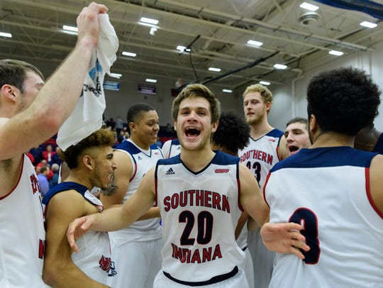 USI's Alex Stein (20) celebrates his team's win against