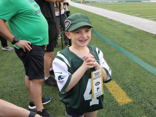The Jets honorary captain for tonight's game, Grace Eline of Gillette, NJ watches her team take the field for pre game warm ups.