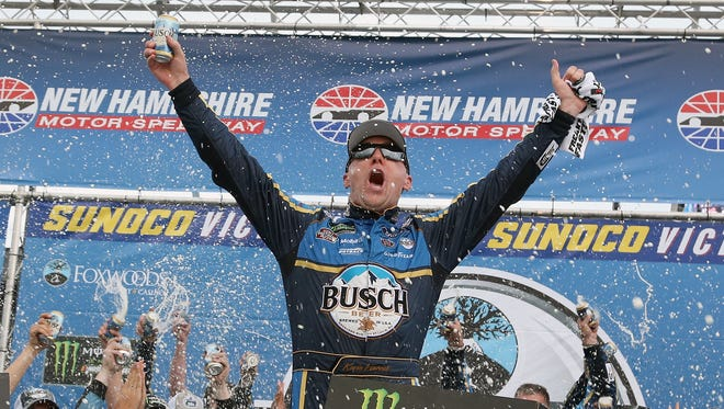 Kevin Harvick, celebrates after winning the Foxwoods Resort Casino 301 Sunday at New Hampshire Motor Speedway.
