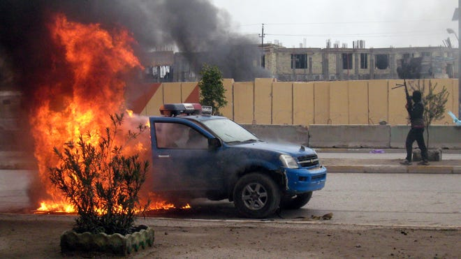 A vehicle burns in Anbar province.
