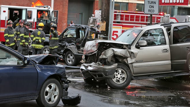 A shoplifting suspect fleeing from police caused a three-vehicle crash near Fountain Square that killed a woman and left two people in critical condition, Monday, June 8, 2015.