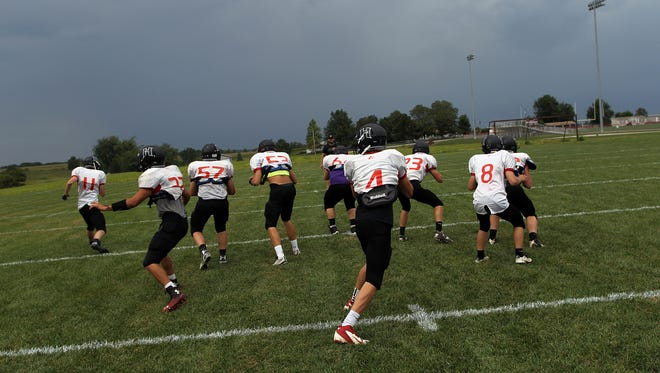 Highland's offense runs a play during practice on Monday, Aug. 17, 2015.