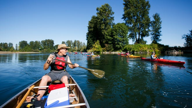 Russ Woodward paddles along the Willamette River on day two of Paddle Oregon on Tuesday, Aug. 16, 2016. Woodward has been participating in the trip for 15 years, and after leading his own pod of canoes for several years now functions as a roaming safety guide for paddlers.