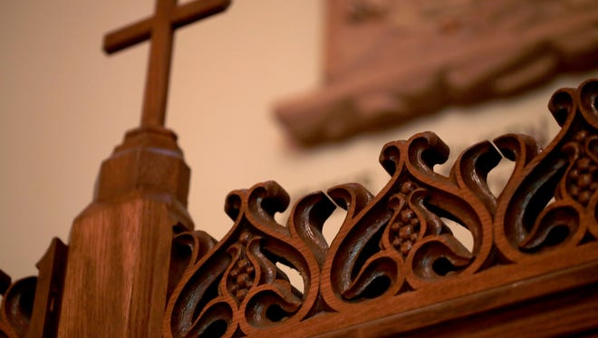 Carved wood detail on the confessional.