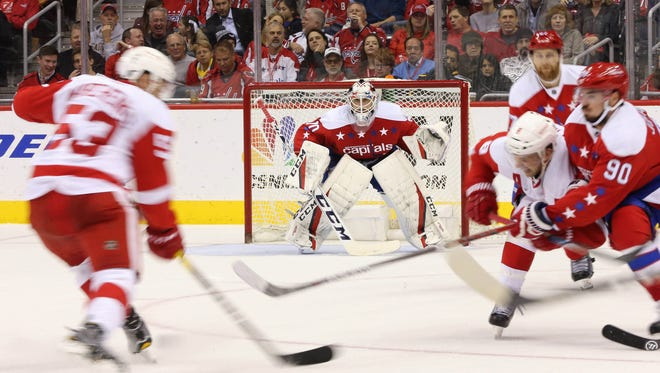 Capitals goalie Braden Holtby prepares to make a save on Red Wings defenseman Alexey Marchenko in the second period Friday, Nov. 18, 2016 in Washington.