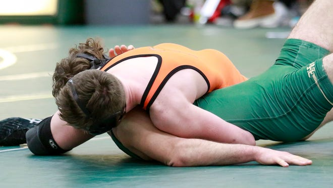 Brighton's Nick Bleise pins Howell's Jacob Palmetier at 145 pounds in 1:29.