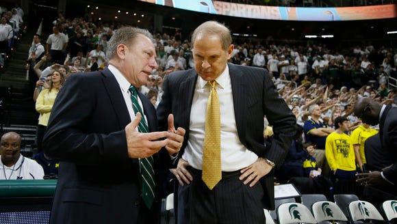 Michigan State coach Tom Izzo, left, talks with Michigan