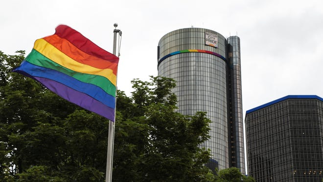 An LGBTQ pride flag flies at Hart Plaza in downtown Detroit on Tues., June 6, 2017after an event to kick off the annual Motor City Pride Fest as a Motor City Pride logo is displayed on the Renaissance Center.