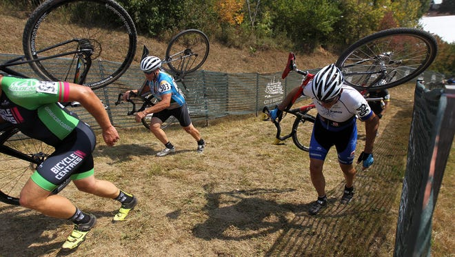 A group of cyclists ascend up the race course at the Johnson County Fairgrounds on Friday, Sept. 15, 2017.
