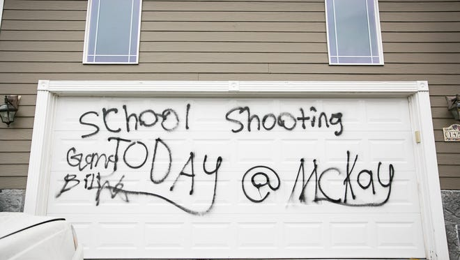 Spray paint threatening violence at McKay High School was painted on several homes in the 1400 block of Horizon Ridge Drive NE in Keizer on Wednesday, Nov. 15, 2017.  The neighborhood is located in the McNary High School boundaries; McKay High School is about eight miles away in Salem.