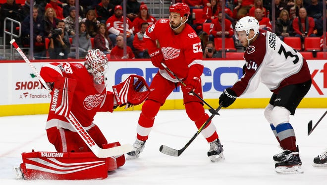Red Wings goalie Jimmy Howard (35) makes the save on Avalanche center Carl Soderberg (34) in the first period on Sunday, Nov. 19, 2017, at Little Caesars Arena.