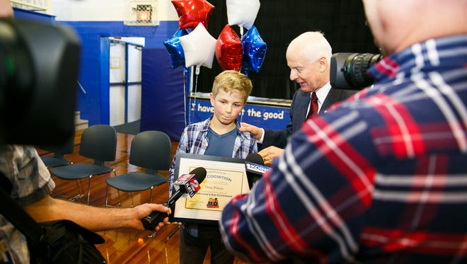 Oregon Secretary of State Dennis Richardson helps coach Willamette Valley Christian student Dom Peters through his first official media questions as newly elected Oregon Kid Governor on Monday, Nov. 27, 2017, in Brooks. An inauguration will be held at the Capitol on Jan. 9, when Peters' year-long term begins.