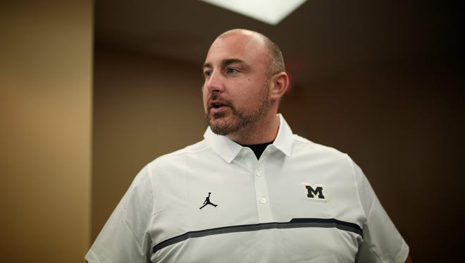 Michigan assistant coach Chris Partridge.