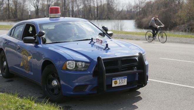 A Michigan State patrol car is seen on Belle Isle on Tuesday, April 29, 2014.