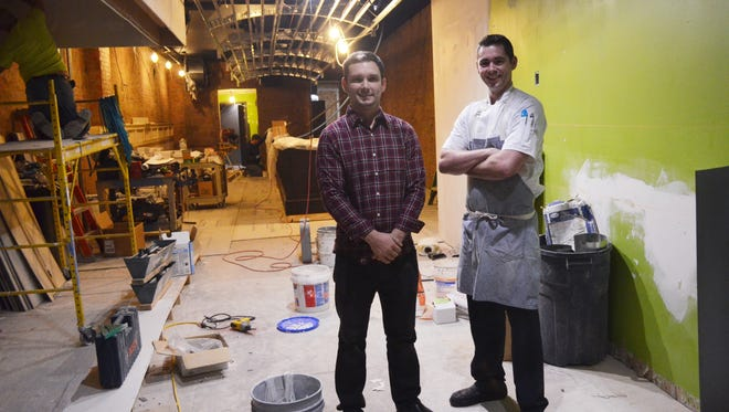 Cory Kent, left, who currently manages Red's Alehouse in North Liberty, and Benjamin Smart, the chef at Big Grove Brewery in Solon, are pictured inside the future location of Pullman, an upscale diner in downtown Iowa City. Kent and Smart are among a group of business partners who are set to open the new restaurant next month or early next year.