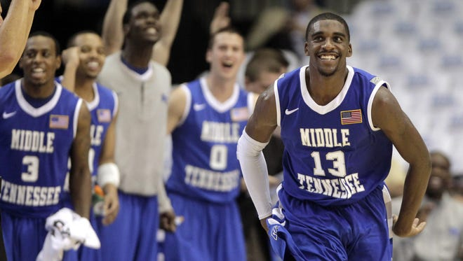 Middle Tennessee's Bruce Massey (13) reacts after making a three-point basket during the second half of an NCAA college basketball game against UCLA in Los Angeles, Tuesday, Nov. 15, 2011. Middle Tennessee won 86-66. (AP Photo/Jae C. Hong)