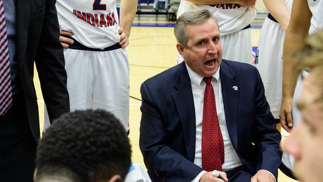 USI Head Coach Rodney Watson talks with his team during a timeout in the second half against the Lewis University Flyers at USI's Physical Activities Center in Evansville, Ind., Thursday, Nov. 30, 2017. After going into overtime, the Screaming Eagles defeated the Flyers, 84-75.