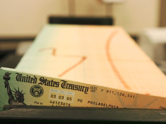 Social Security checks wait to be mailed.
