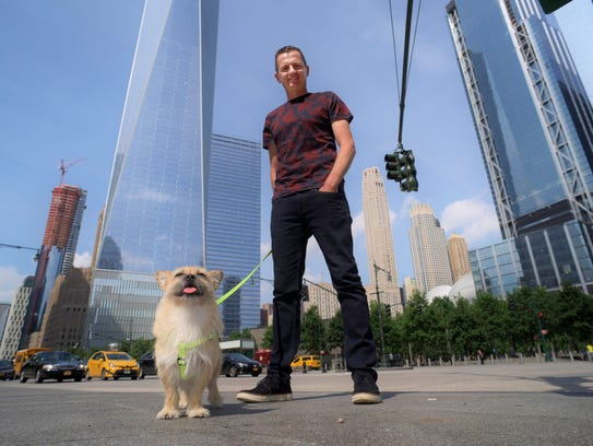 Dion Leonard and his dog, Gobi, pose for a photo in