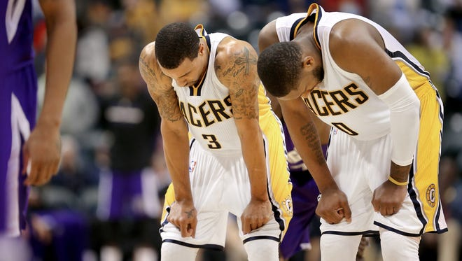 Pacers guard George Hill, left, and teammate C.J. Miles feel their loss closing in during the final seconds of the second half of the game against Sacramento at Bankers Life Fieldhouse on Saturday, Jan. 31, 2015. The Pacers rallied but fell short 94-99 to the Kings.