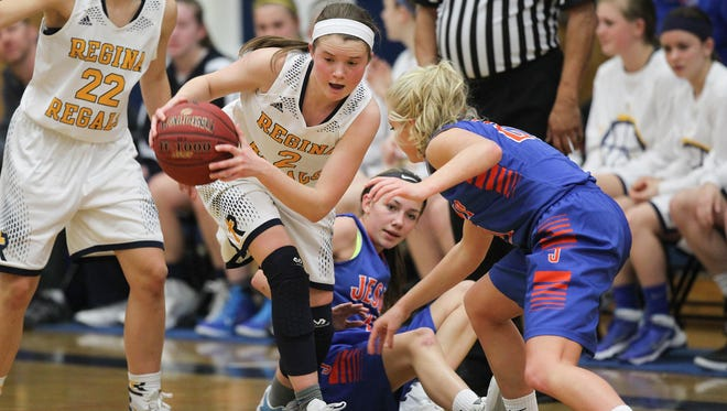 Regina's Mary Crompton steals the ball during the Regals' game against Jesup at Regina on Tuesday, Feb. 16, 2016.