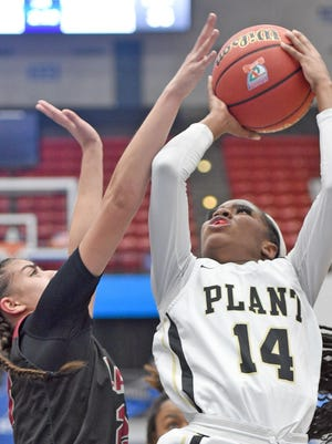 Tampa-Plant's Nyla Jean (14) shoots against Palm Beach Lakes' Zaida Gonzalez (23) during the Class 7A semifinal Friday at the RP Funding Center in Lakeland.