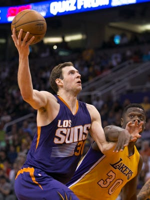The Suns' Jon Leuer puts up a shot past the Lakers' Julius Randle during the fourth quarter of the NBA game at Talking Stick Resort Arena in Phoenix on Wednesday, March 23, 2016.