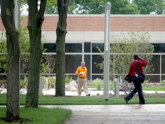 Employees walkabout the ACT grounds on Tuesday, May 28, 2013. Press-Citizen file photo