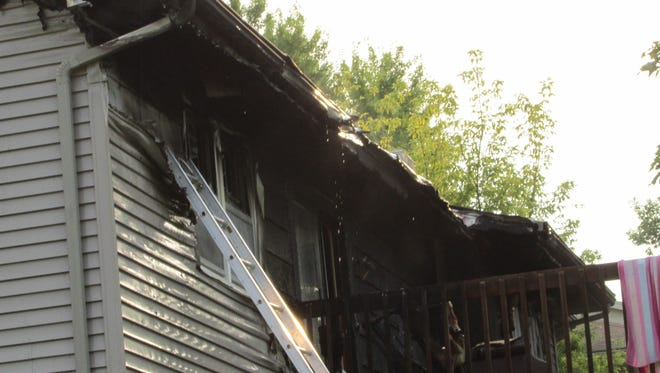 A duplex in Clive sustained extensive damage from a fire started by improperly discarded smoking materials.