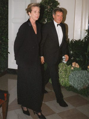 In this file image, Harrison Ford and Melissa Mathison arrive at the White House for a dinner hosted by Bill Clinton