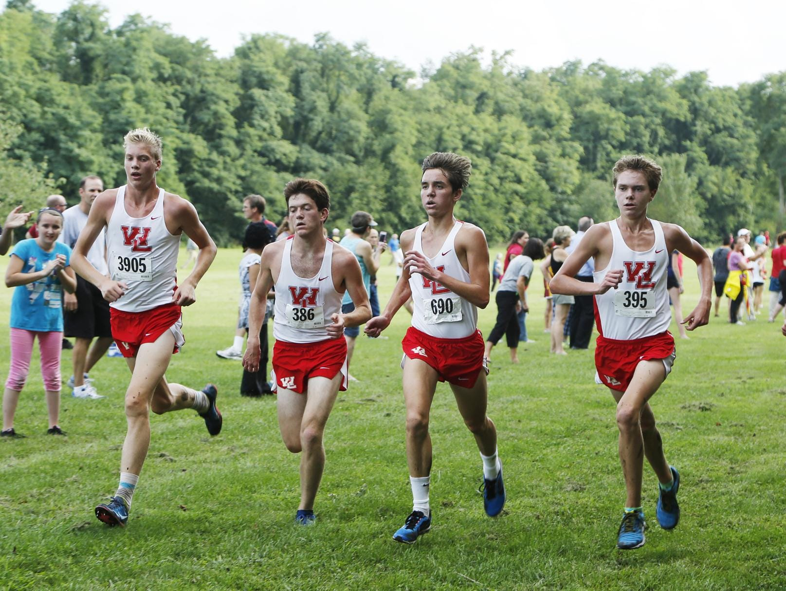 West Lafayette's Cooper Williams, from left, Jake Cohen, Dominic Patacsil, Evan Johnson and Dylan Williams come to the finish line together in the boys race of the City/County cross country meet Tuesday, September 2, 2014, at the Tippecanoe Amphitheatre.