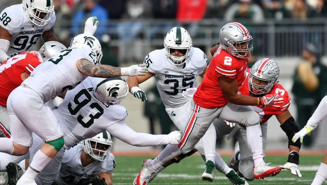 Ohio State running back J.K. Dobbins breaks free from Michigan State's defense during the Buckeyes' 48-3 win Saturday.