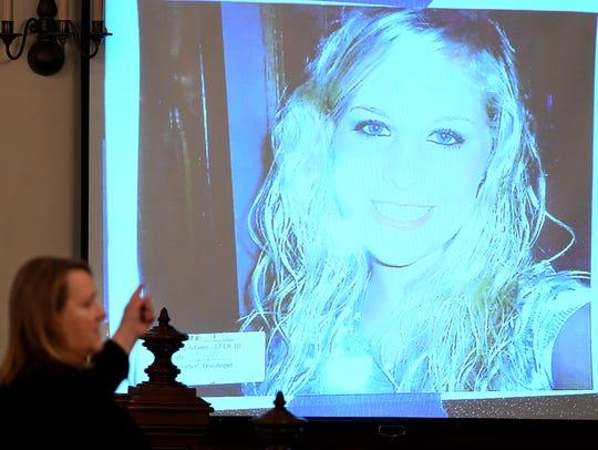 State prosecutor Jennifer Nichols points to a photo