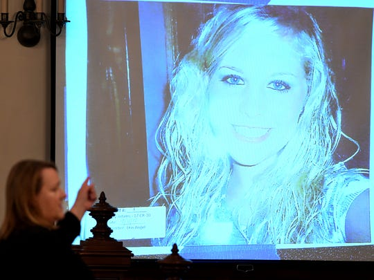State prosecutor Jennifer Nichols points to a photo