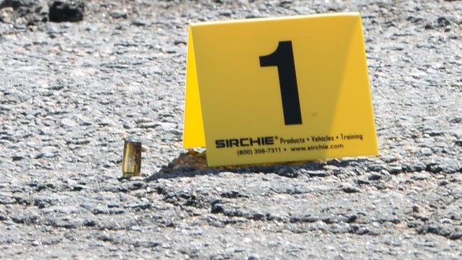 FILE - In this Monday, April 9, 2018, file photo, a shell casing is marked by a yellow evidence placard in Brockton.