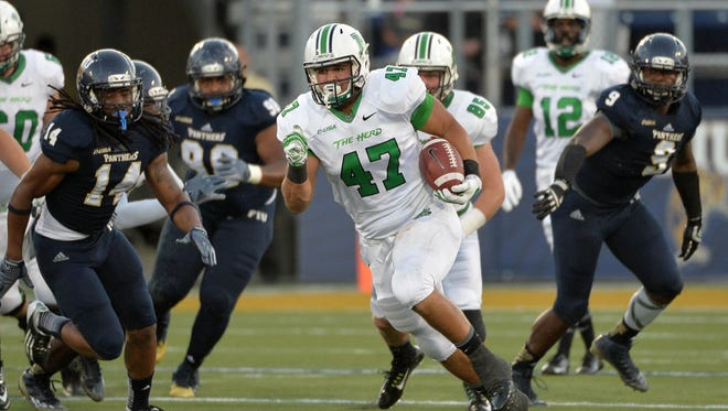 Running back Devon Johnson and Marshall want to be in the College Football Playoff discussion.