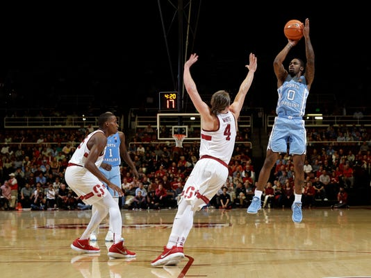 North Carolina guard Seventh Woods (0) shoots over Stanford guard Isaac White (4) during the second half of an NCAA college basketball game Monday, Nov. 20, 2017, in Stanford, Calif. (AP Photo/Marcio Jose Sanchez)