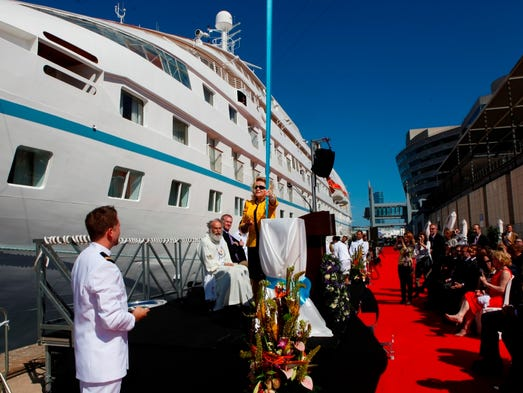 Nancy Anschutz, wife of Windstar Cruises owner Philip Anschutz, christens the line's new Star Pride at a ceremony in Barcelona on May 5, 2014.