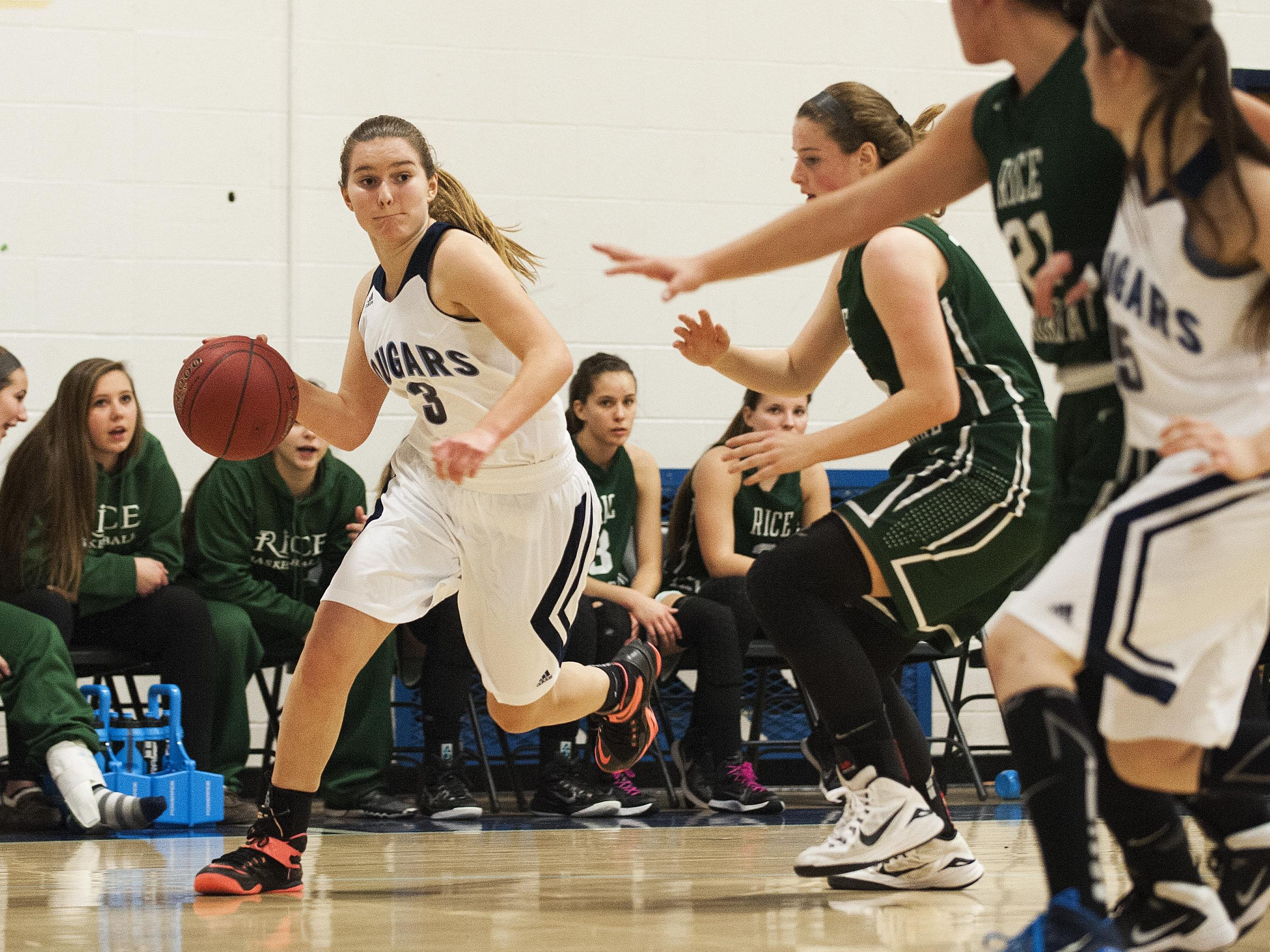 Mount Mansfield guard Grace Pontius (3) drives to the hoop during the girls basketball game between the Rice Green knights and the Mount Mansfield Cougars at MMU High School on Friday night December 4, 2015 in Jericho.