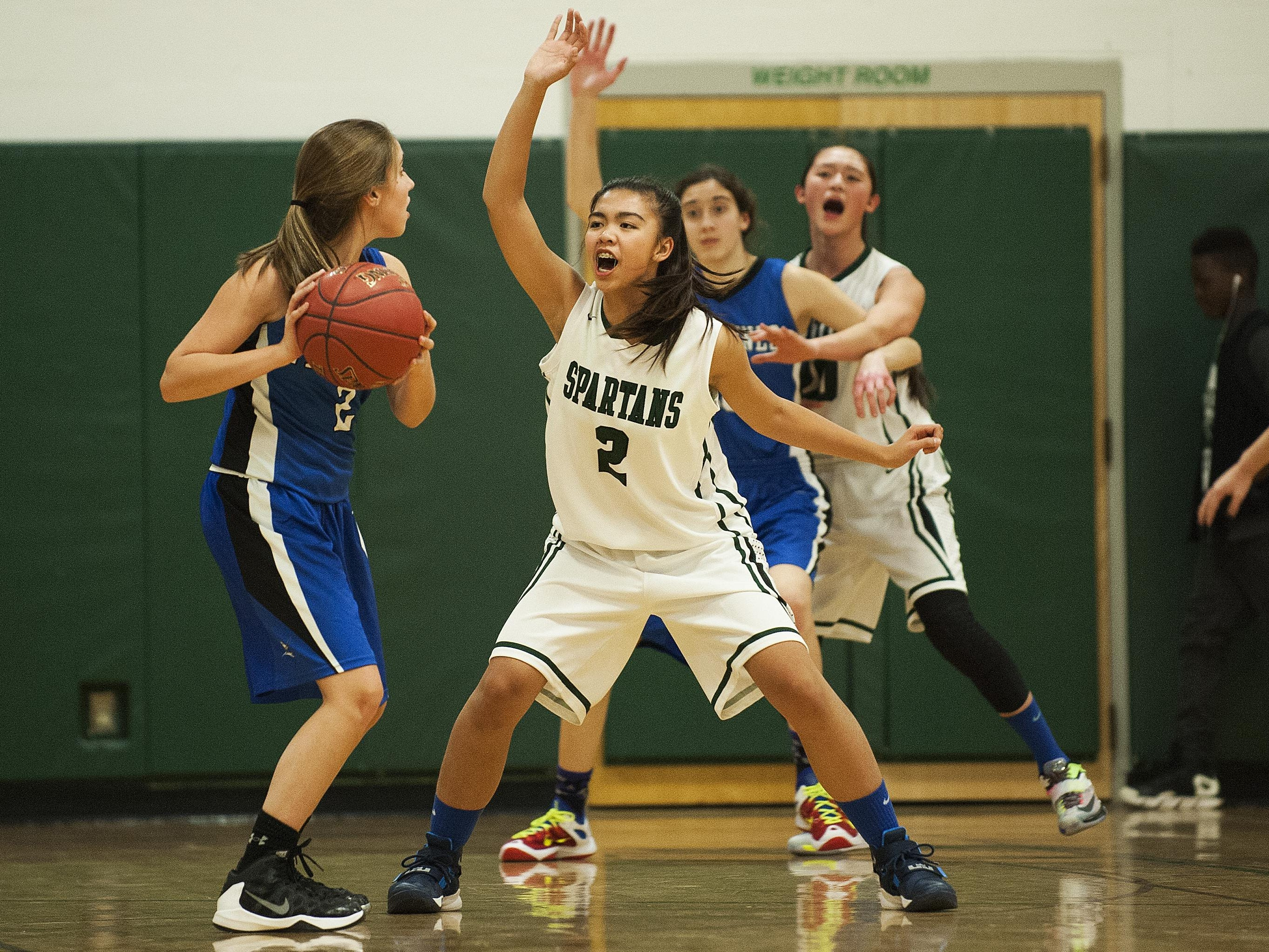Winooski's Marie Ly (2) guards Vergennes' Shay Pouliot (2) during the girls basketball game between Vergennes and Winooski at Winooski High School on Wednesday night.