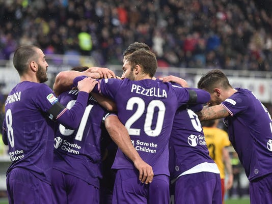 Fiorentina's Vitor Hugo celebrates with teammates after scoring the Serie A soccer match between Fiorentina and Benevento, at the Artemio Franchi stadium in Florence, Italy, Sunday, March 11, 2018. (Maurizio Degl'Innocenti/ANSA via AP)